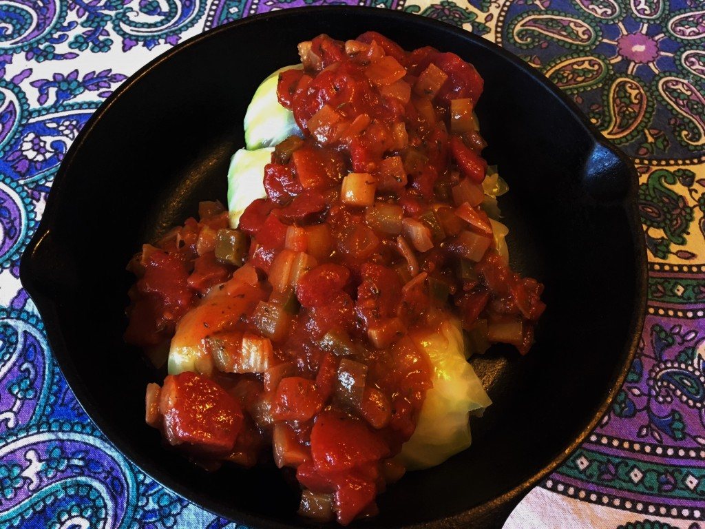 red beans and rice stuffed cabbage topped with creole sauce